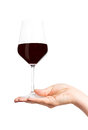 Glass of wine in hand red female Royalty Free Stock Photos