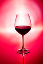 Glass wine red background Royalty Free Stock Photography