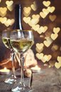 Glass with wine on romantic Valentines day background. Royalty Free Stock Photo