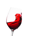 Glass of wine with splash red Royalty Free Stock Image