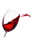 Glass of wine with splash red Stock Images