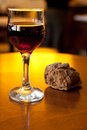 Glass of wine on a table with bread in defocus Royalty Free Stock Photo