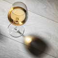Glass of wine on wooden table top view white Royalty Free Stock Images