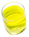 Glass of yellow carbonated water with vitamin Stock Images