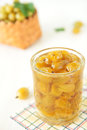 Glass with yellow gooseberry jam Royalty Free Stock Photography