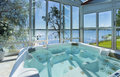Glassed in jacuzzi by ocean Royalty Free Stock Photo