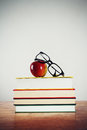 Glasses apple pile books Royalty Free Stock Photos