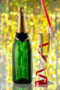 Glasses and bottle of champagne serpentine closeup celebration new year card design with christmas scene Royalty Free Stock Photos