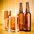 Glasses and bottles of beer on the wooden background Stock Photo