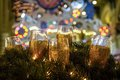 Glasses in the branches of spruce wine with christmas lights Royalty Free Stock Photo