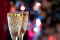 Glasses of champagne with candle on bokeh festive a colorful Royalty Free Stock Photography