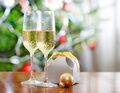 Glasses of champagne and Christmas present Royalty Free Stock Photography