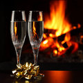 Glasses with champagne, fire as the background Royalty Free Stock Photo