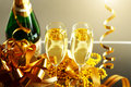 Glasses of champagne with gift box background lights Stock Photo