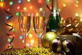 Glasses of champagne with gift box background lights Stock Images