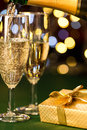 Glasses of champagne and present special occasion for gold decoration Stock Photography