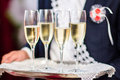 Glasses with champagne silver tray Royalty Free Stock Photography