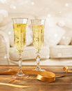 Glasses of champagne two with gold ribbon vintage style effect and sparkle background Stock Photos