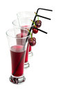 Glasses of cherry juice on white background Royalty Free Stock Images