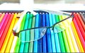 Glasses and colors pencil art background Stock Image