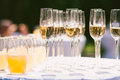 Glasses with different alcohol and nonalcohol drinks:  champagne and juice Royalty Free Stock Photo