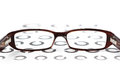 Glasses on eye test chart Royalty Free Stock Photos