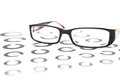 Glasses on eye test lying chart Royalty Free Stock Photos