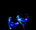 Glasses of fresh blue cocktail with ice make cheers on tint light space for text Stock Photos