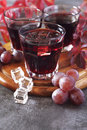 Glasses of grape juice, pink grape and autumn leaves Royalty Free Stock Photo