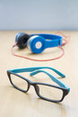 Glasses and headphone on floor Royalty Free Stock Photo