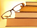 Glasses lying on books Royalty Free Stock Photos