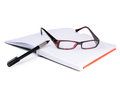 Glasses notebook and pen office Royalty Free Stock Photo