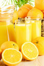 Glasses of orange juice and fruits Stock Photography