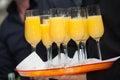 Glasses of orange juice the waitress filled up some Stock Image