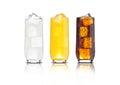 Glasses of orange soda, cola and lemonade iced
