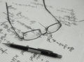 Glasses on paper sheets with equations sketch style illustration of squared containing handwritten formulas or referring to Stock Image
