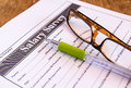 Glasses and pen on salary survey from Royalty Free Stock Photo