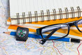 Glasses pencil compass and map conceptual image of adventure Stock Image