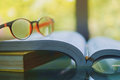 Glasses placed on the opened book Royalty Free Stock Photo