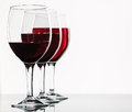 Glasses of red wine on a white background Royalty Free Stock Images