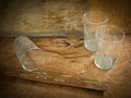Glasses and spider web dirty old glass with inside on wooden background Royalty Free Stock Photography