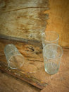 Glasses and spider web dirty old glass with inside on wooden background Stock Photos