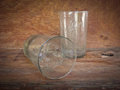 Glasses and spider web dirty old glass with inside on wooden background Royalty Free Stock Photos