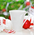 Glasses of tea and Christmas decorations Stock Photos