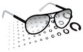 Glasses with a test chart Royalty Free Stock Photos