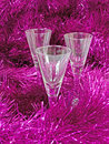 The glasses in the tinsel Royalty Free Stock Photography