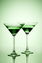 Glasses two filled with green beverage Royalty Free Stock Photos