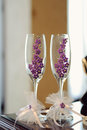 Glasses with Violet Flowers Royalty Free Stock Image