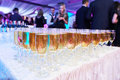 Glasses with white sparkling wine in row at restaurant event Royalty Free Stock Photo