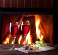 Glasses of wine cheese and nuts romantic still life near the fireplace Royalty Free Stock Image